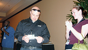 New OMTI Technical Support staffer Dustin Scoggin  punches conference attendees' CEU cards.